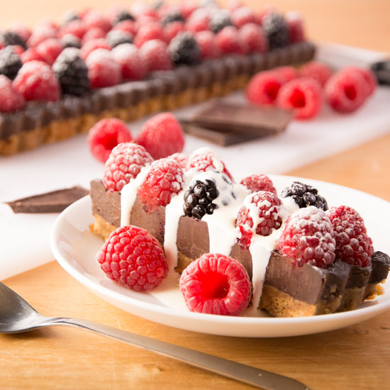 Holly-Cooks-chocolate-raspberry-and-blackberry-one-slice-covered-in-cream550