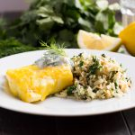 Steamed fish with rice and herbs